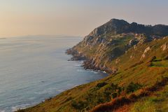 Coast cliffs at dusk in Costa da Vela, Galicia, Spain. stock image