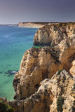 Coast with cliffs in Lagos at Algarve in Portugal. Coast with rocky cliffs and turquoise sea in Lagos at Algarve in Portugaln royalty free stock photography