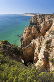 Coast with cliffs in Lagos at Algarve in Portugal. Coast with rocky cliffs and turquoise sea in Lagos at Algarve in Portugaln royalty free stock photo