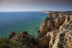 Coast with cliffs in Lagos at Algarve in Portugal. Coast with rocky cliffs and turquoise sea in Lagos at Algarve in Portugaln stock images