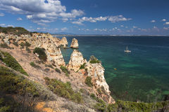 Coast with cliffs in Lagos at Algarve in Portugal. Coast with rocky cliffs and turquoise sea in Lagos at Algarve in Portugaln stock photos