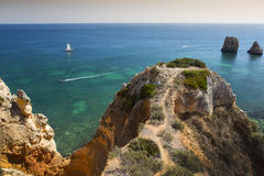 Coast with cliffs in Lagos at Algarve in Portugal. Coast with rocky cliffs and turquoise sea in Lagos at Algarve in Portugaln royalty free stock images