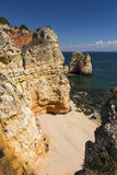 Coast with cliffs in Lagos at Algarve in Portugal Royalty Free Stock Photography
