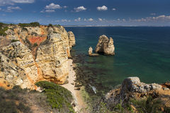 Coast with cliffs in Lagos at Algarve in Portugal Royalty Free Stock Images