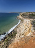 Coast with cliffs in Lagos at Algarve in Portugal Stock Photos