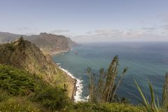 Coast of Madeira island. Coast with cliffs, mountains and trails on the island of Madeira, Portugal royalty free stock image