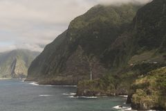 Coast of Madeira island. Coast with cliffs, mountains and trails on the island of Madeira, Portugal stock image
