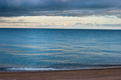 Coast in cloudy day Stock Images