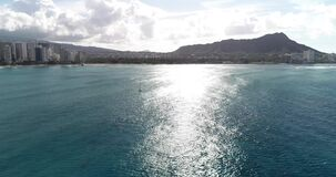 Aerial point of view, Hyperlapse of panorama off the coast of Hawaii, in blue water _