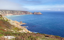 Coast of Cornwall England in autumn with mist and blue sky Stock Images