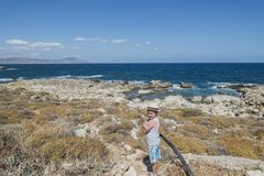 Coast of Crete island. Typical rocky coastline on Crete  , Greece , Europe . And the mountains in background Stock Photography