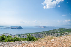 Coast of Croatia on a beautiful sunny day overlooking rocky islands from the green shore Royalty Free Stock Photos