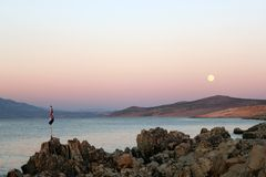 Coast with Croatian flag and moon at night. Coast with Croatian national flag and full moon at night royalty free stock image