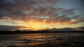 Coast of Dublin. Sun setting on the coast of Dublin, Ireland Royalty Free Stock Photography