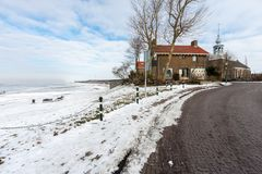 Coast of Dutch village Urk in wintertime with church and houses Royalty Free Stock Photo