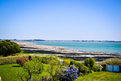 Coast and gardens in the North of France at summer-peaceful. At low tide in morbihan, france Stock Image