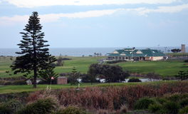 The Coast Golf Club and golf course in Little Bay at Sunset. Royalty Free Stock Photo