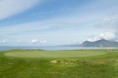 Coast golf green. Royalty Free Stock Image