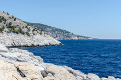 Coast of The Greek island Thassos. Blue aegean sea. Coast of The Greek island Thassos. Blue aegean sea and a small rocky island nearby seen from paradise beach Stock Images