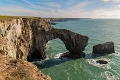 The Green Bridge of Wales, UK. Coast at the Green Bridge of Wales near Castlemartin and Merrion in Pembrokeshire, Wales, UK stock photography