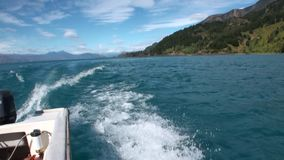 Coast of green mountain river view from boat in Patagonia Argentina. Unique landscape of wildlife. Beautiful nature background. Travel and tourism in stock video footage
