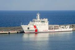 Coast guard's boat in the port of Catania in Sicily. Catania, Italy - July 3, 2017: Dattilo-class patrol boat - an italian coast guard or coastguard vessel Royalty Free Stock Photography