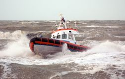 Coast Guard. In storm at sea Royalty Free Stock Photography
