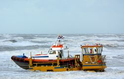 Coast guard. Driving their boat into the sea Stock Images