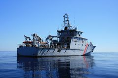 Coast guard. In the quiet ocean Royalty Free Stock Photo