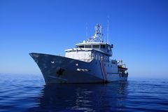 Coast guard. In the quiet ocean Royalty Free Stock Image