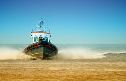 Coast guard. Full speed towards the beach Stock Images