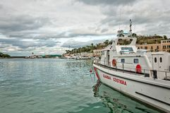 Coast guard boat and harbor in Ischia island, Italy Royalty Free Stock Images