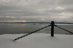 Coast Guard boat patrolling bay on a calm cloudy winter morning. Canadian Coast Guard boat patrolling the waters off the Gaspe coast on a calm winter morning Royalty Free Stock Photography