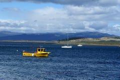 Coast guard boat in Ushuaia Harbor. Yellow coast guard boat in Ushuaia Harbor, Argentina Stock Photos