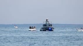 Coast Guard checks another boat. BRIDGEPORT, CT - JUNE 2016 Coast Guard checks another boat stock footage