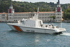 Coast Guard cutter on a river. Coast guard vessel in turkey on bosphorus river with parliament building in background Royalty Free Stock Photo