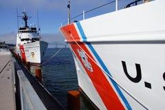 Coast Guard Cutter Steadfast and CG Cutter Alert. Coast Guard Cutter Steadfast,  anchored facing  CG Cutter Alert Astoria, Oregon Royalty Free Stock Photos