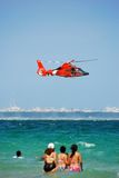 Coast guard helicopter. Rescue helicopter on a recue mission over the ocean Stock Photography