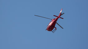 Coast Guard Helicopter. Red Coast Guard Helicopter in flight Royalty Free Stock Photos