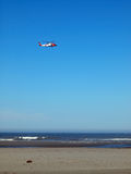 A Coast Guard Helicopter. Patrolling the Shoreline on a Clear Day Royalty Free Stock Photography