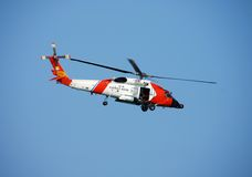 Coast guard helicopter. Military chopper going out for a sea rescue Stock Photos