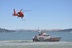 Coast guard helicopter and boat. Articles regarding coast guard, safety, search and rescue Royalty Free Stock Photo