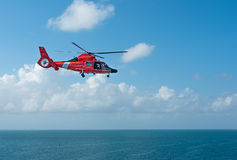 Coast Guard Helicopter over water. Coast Guard Helicopter flying over ocean Stock Photos