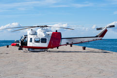 Coast guard helicopter. Waiting for passengers on sea dock Royalty Free Stock Image