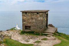 Coast Guard hut with South Stack Lighthouse in the background, near Holyhead, Anglesey, Gwynedd, Wales, UK stock photo