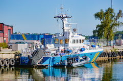 Coast guard KBV 302. Karlskrona, Sweden - August 03, 2015: KBV 302 of the Swedish coast guard moored at harbor with KBV 422 rubber raft. Swedish coast guard is stock images