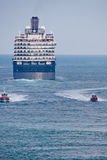 Coast Guard Leaving Blue and White Cruise Ship Royalty Free Stock Image