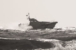 The Coast Guard patrol boat along the sea. Royalty Free Stock Photo