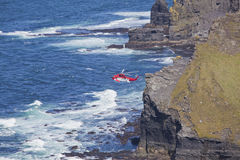 Coast Guard Rescue Helicopter. Sea rescue helicopter cliff and coastal search. Cliffs of Moher, Ireland royalty free stock image