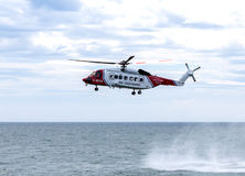 Coast Guard Rescue. UK coast guard helicopter on a rescue mission Royalty Free Stock Photo